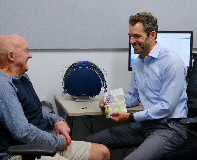 Audiology South director Anthony Rowcroft (right) talks to Dick Tayler about his hearing. PHOTO:...