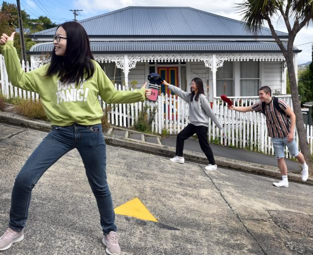 Lei Zhou (left) and Ting Chen, both of China, and Flynn Mankelow, of Oamaru, see the sights of...