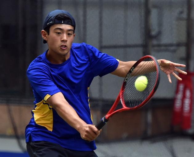 Peter Hartono looks to volley the ball at a match at the Edgar Centre yesterday. PHOTO: GREGOR...