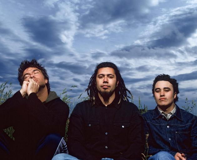 Riki Gooch (far right) with Trinity Roots band members Warren Maxwell (left) and Rio Hemopo in...