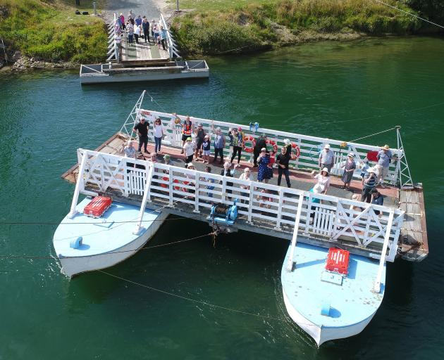 Visitors to the Picnic at the Punt Tuapeka Mouth Punt 125th jubilee yesterday celebrate with a...