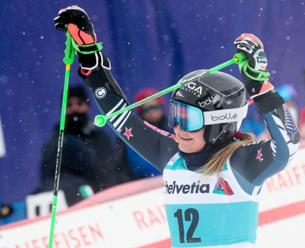 Queenstown's Alice Robinson celebrates winning the gold medal  at the  FIS Giant Slalom World Cup...