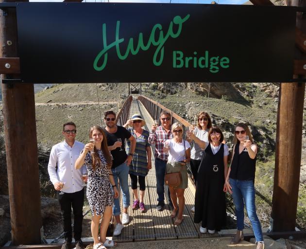 Raising their glasses to the Hugo Bridge are (from left) Scotty Blythen (Hugo friend), Kayleigh...