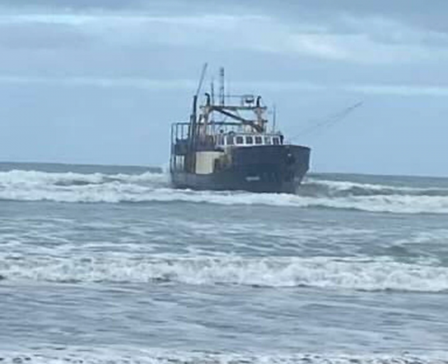 The fishing vessel Remus beached on Big Bay beach. Photo: Supplied via NZH