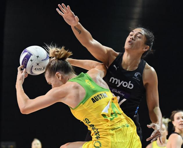 Kiera Austin of Australia is challenged by Sulu Fitzpatrick of New Zealand during the Constellation Cup International Test match. Photo: Getty Images
