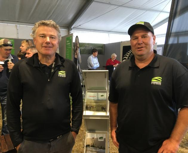 Federated Farmers North Canterbury territory manager Harry Matthews (left) chats to national...