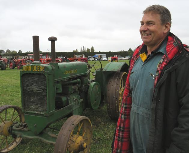 Malcolm Nell with the 1944 John Deere AR steel wheeled tractor up for auction, which was...