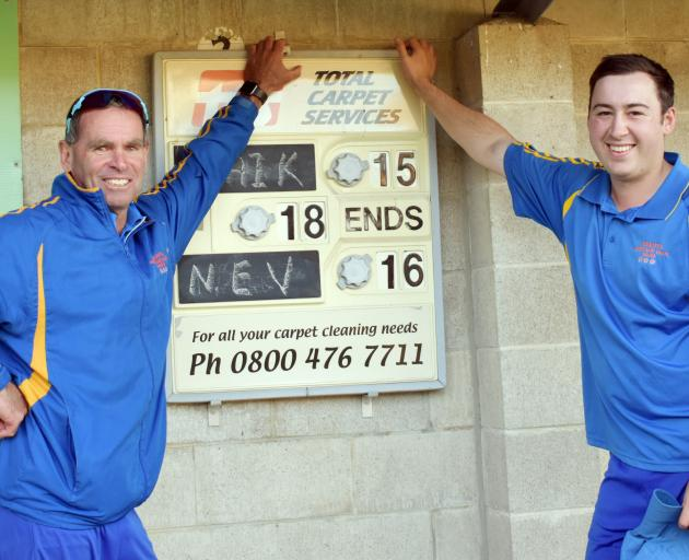 The North East Valley pair of Roger Stevens (left) and Keanu Darby at the scoreboard after...