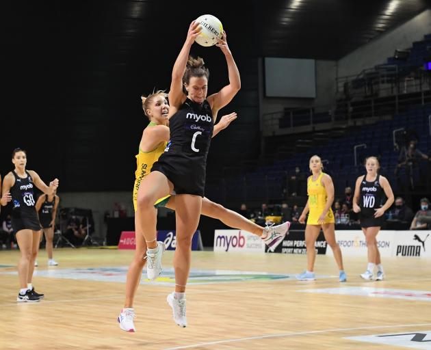 Claire Kersten of New Zealand (R) and Kate Moloney of Australia compete for the ball during New...