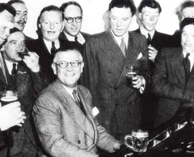 Sir Archibald McIndoe and his boys singing at a Guinea Pig Club reunion in 1948. PHOTO: SUPPLIED...