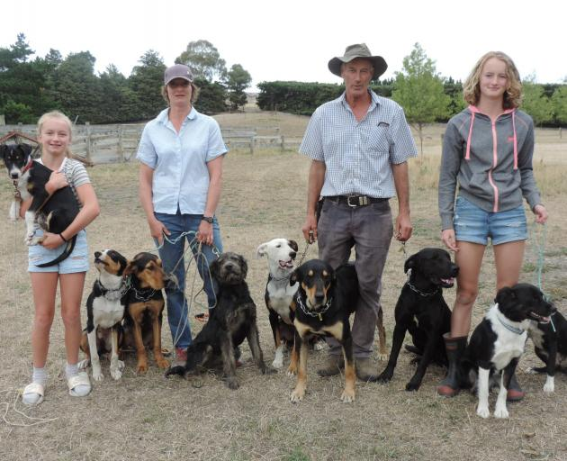 Ramona and Jim Sidey with their daughters Millie, 13, left, and Hannah, 14, and their team of...
