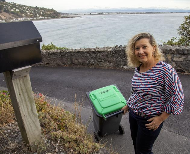 Liza Sparrow puts out a green bin. Photo: Geoff Sloan