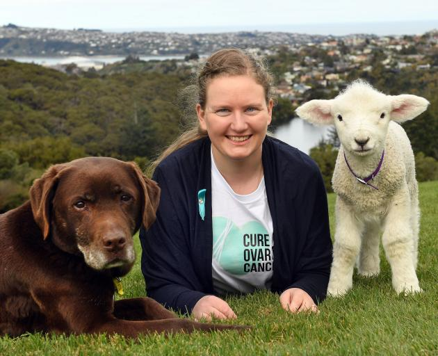 Cure Our Ovarian Cancer founder Jane Ludemann relaxes with Stella the dog and Milly the lamb. ...