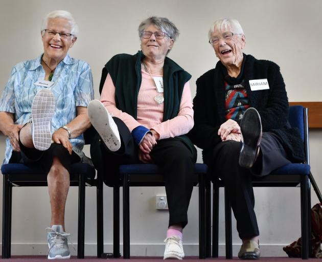 Reina Guise, Zona Fleury and Miriam Jarvis stretch their legs at their weekly exercise class....