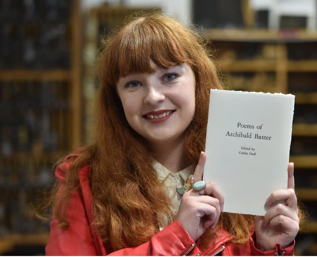 University of Otago student Caitlin Duff (19) holds a book of poems by Dunedin conscientious...