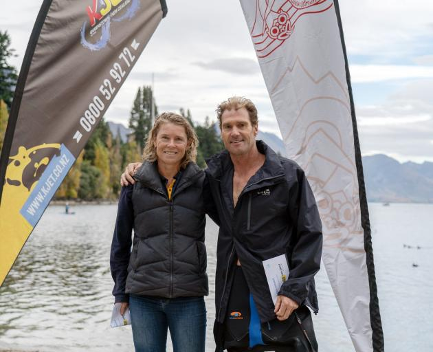 Anne Gray, of Dunedin, and Brent Foster, of Auckland, celebrate their victories in the 3.8km event.