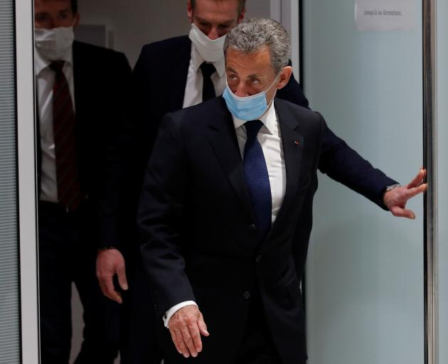 Former French President Nicolas Sarkozy leaves after the verdict in his trial on charges of corruption and influence peddling in Paris. Photo: Reuters