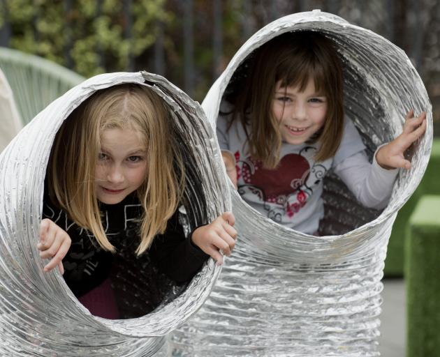 St Kilda sisters Morgan (left, 8) and Bianca (7) Keen have fun at the Sport Otago stall at the...