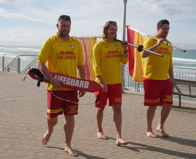 Surf lifeguards (from left) Cam Third, of St Kilda Surf Life Saving Club, Otago-Southland club...