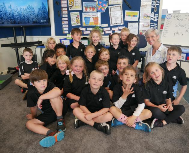Poet Liz Breslin and Anderson's Bay School pupils after a City of Literature Primary...