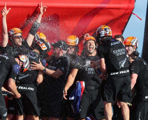 Team New Zealand celebrate winning the 36th America's Cup in Auckland. Photo: Reuters