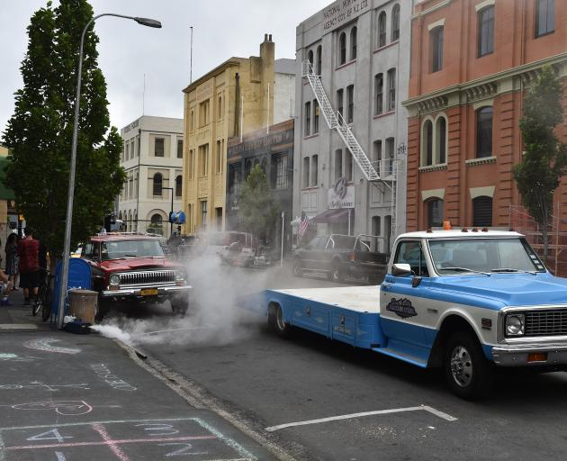 A smoke machine is activated on the film set in Vogel St.