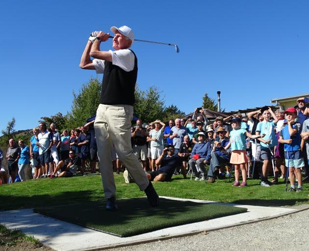 New Zealand golfing great Sir Bob Charles (85) plays the first shot off the first tee on the new...