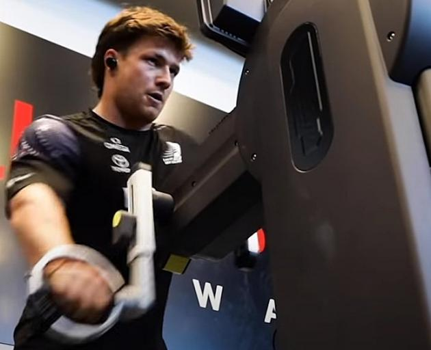 Finn Henry works on a grinder as he trains with Team New Zealand. PHOTO: YOUTUBE