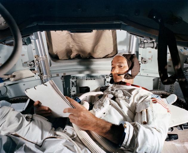Command Module pilot Michael Collins practices in the CM simulator at Kennedy Space Cente. Photo: NASA/Handout via Reuters