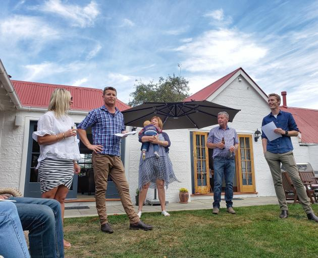 Michael Pavletich (second from left) speaks during Station Peak's centenary celebrations, watched...