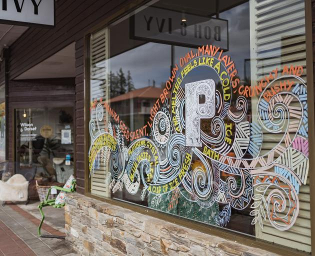 A shop window in Helwick St decorated as part of the Wanaka Festival of Colour's ''Windows Over...