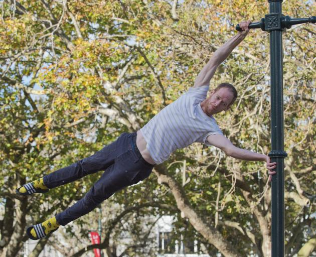 Swinging into the  Octagon yesterday ahead of his Dunedin Arts Festival show is physical theatre...