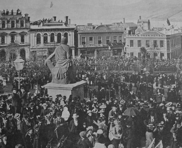 A jubilant crowd estimated at 30,000-40,000 throngs Dunedin's Octagon, on May 18, 1900, following...
