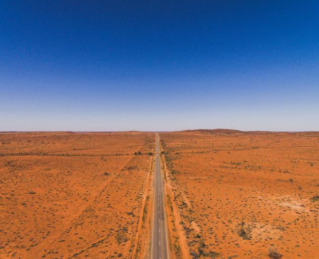 Drone footage of a highway from outside Broken Hill, New South Wales in the Australian Outback. Photo: Getty Images