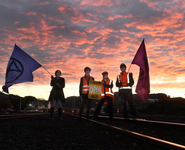 Extinction Rebellion Otepoti activists block the railway line at the Dunedin Railway Station to...