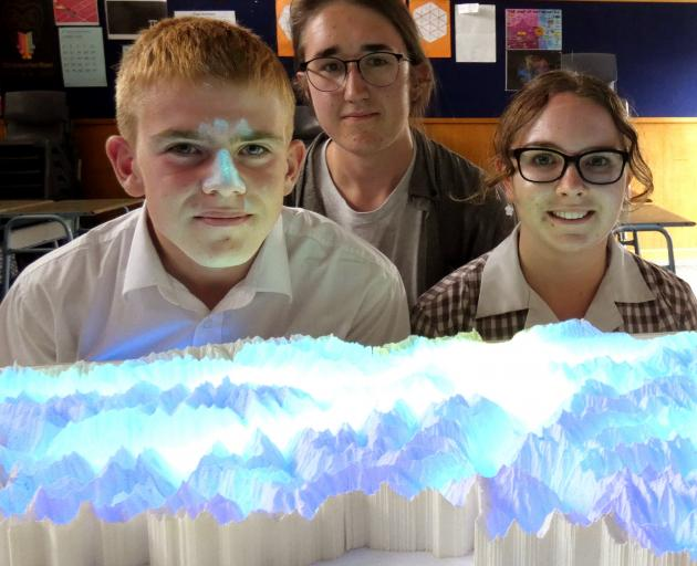 Dunstan High School pupils (from left) James Avenell (14), Niall Asher (17) and Emily Attfield ...