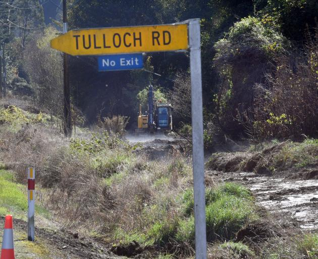 Contractors clear the bush from the side of State Highway 8 as it enters Manuka Gorge for the...