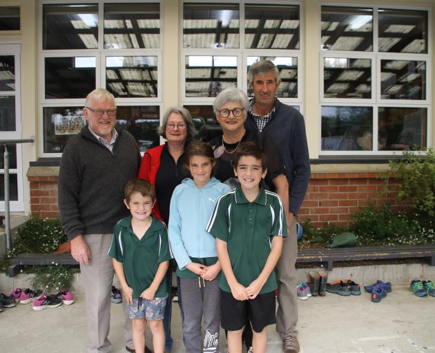 Grandparents (from left) Mike and Patty Robinson and Pauline and Robert Weir spend time with...