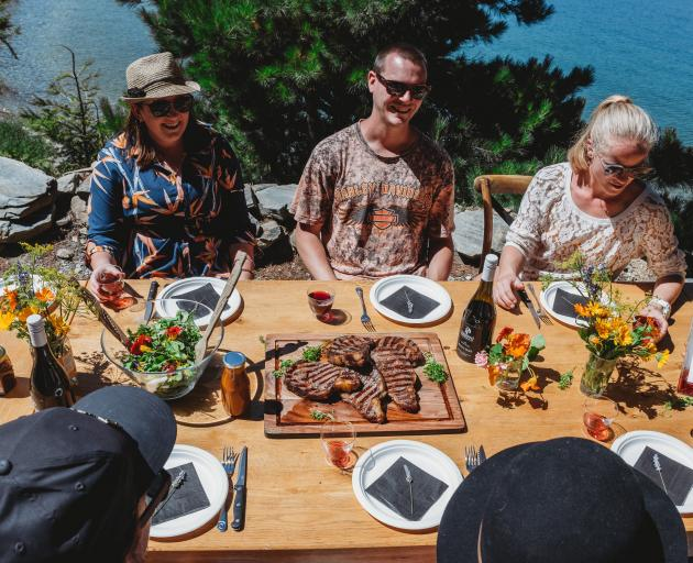 Forage and Feast guests gather at a lakeside location for a freshly prepared all-local lunch....