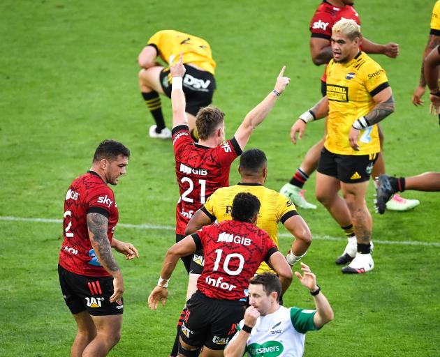 Mitchell Drummond and the Crusaders celebrate their golden point win over the Hurricanes. Photo:...