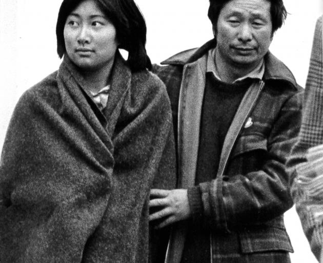 Gloria  and her father Jimmy Kong leave the Oamaru police station after they were reunited....