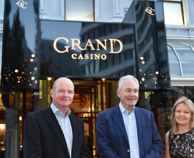 Outside the rebranded Grand Casino in Dunedin are (from left) director Peter Treacy, chairman...