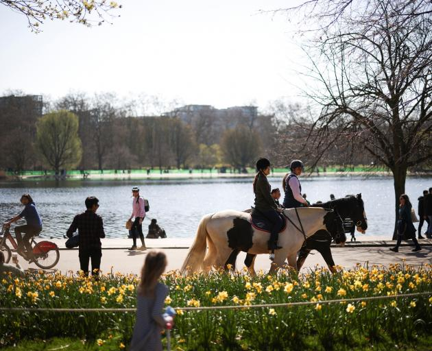 People out and about enjoying sunshine and fresh air in London's Hyde Park on Sunday. Photo:...