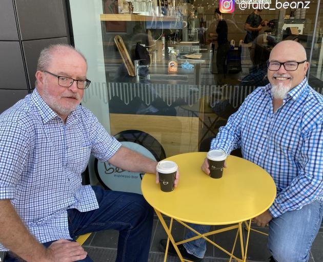 Anthony Brady and John Laing take a morning coffee break in Cashel Mall. Photo: Chris Barclay