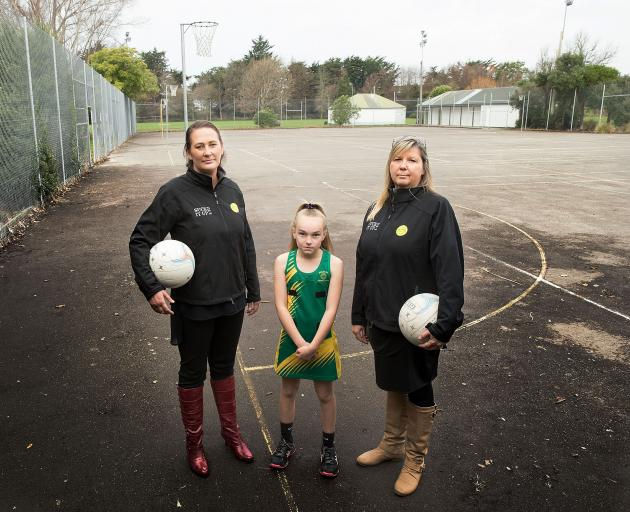 Belfast netball coaches Nikki Martin and Karen Ellis with 11-year-old Asheigh Peters. Photo:...
