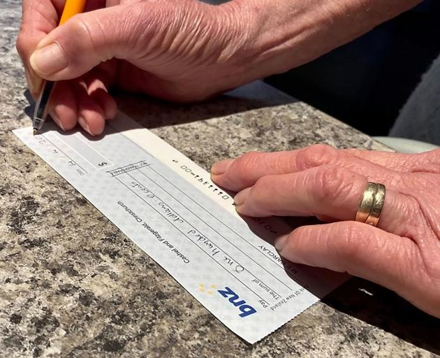 Paying by cheque is becoming obsolete, to the disappointment of many seniors. Photo: Geoff Sloan