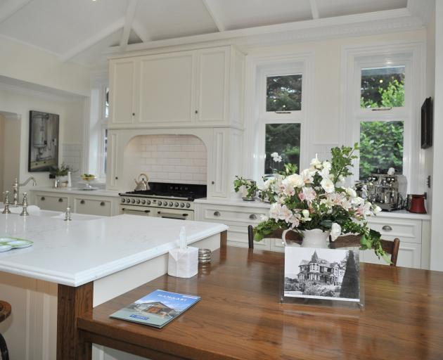 Mod cons are hidden from view in the traditional-style kitchen.