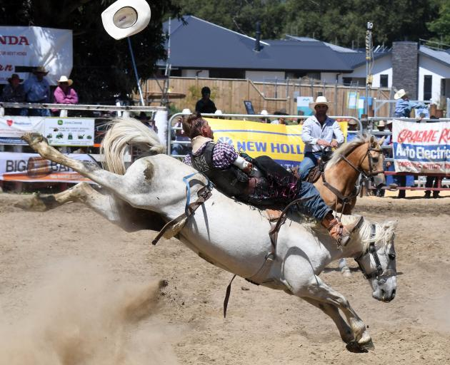 John Hughes loses his hat during the open bareback at Outram rodeo this year. PHOTO: OTAGO DAILY...