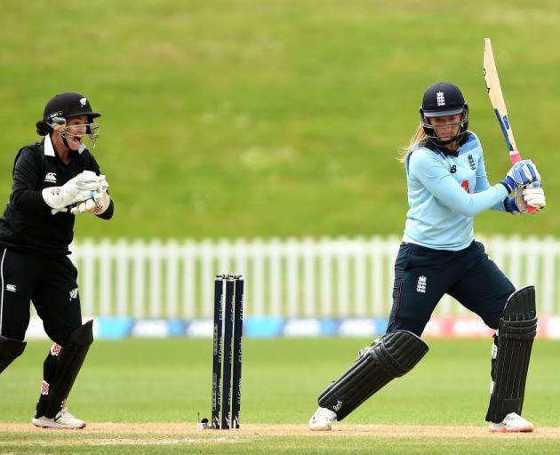 Otago White Fern Katey Martin celebrates taking a catch to get England's Sophie Ecclestone out...