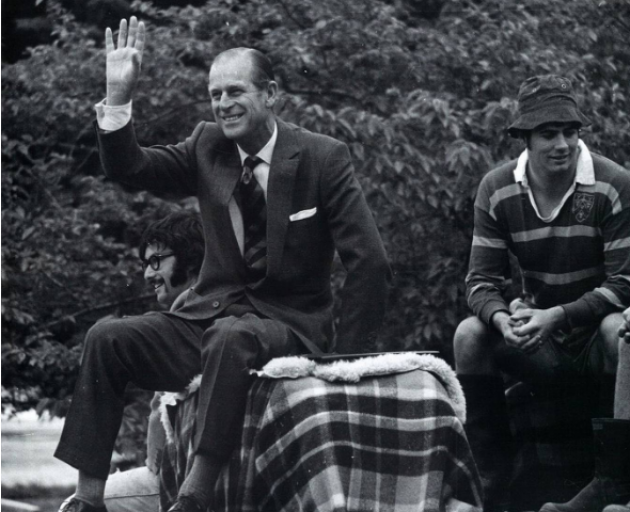 Prince Philip with Alistair Mackintosh on the trailer adorned with hay bales as he's transported...